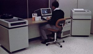 "HP 3000 Series 33 - 16-bits 11MHz. They were integrated into the desk, with a 20MB hard drive on the left, and the computer on the right (with a 1.2MB 8"" Floppy Drive)"